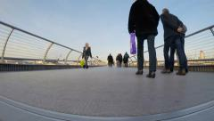 Commuters flow along Millennium Bridge in time-lapse footage Stock Footage
