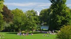 People enjoying the September sun in St James Park Stock Footage