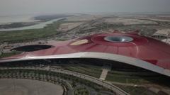 Aerial shot of Ferrari World. Yas Island, UAE. Arkistovideo