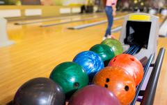 Stock Photo of balls on ball return system in bowling club