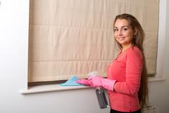 young woman cleaning her house - stock photo