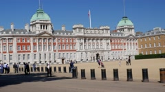 Camera tracks London taxi in front of Horse Guards Parade - stock footage
