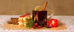 Christmas mulled wine and Advent candle. - stock photo