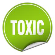 Toxic round green sticker isolated on white Stock Illustration