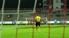 View through goal net,corner,cross,good defense,counterattack stopped with foul. - stock footage