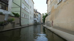 View of old buildings next to Certovka water channel, Prague Stock Footage