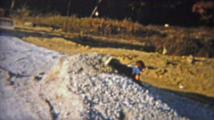 1951: Kid playing in mound of construction dirt. Stock Footage