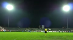 Stock Video Footage of Football goalkeeper walking and follows game, soccer game, reflectors, 4K