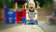 Caucasian Happy cheerful joyful child kid baby boy toddler on a swing  - stock footage