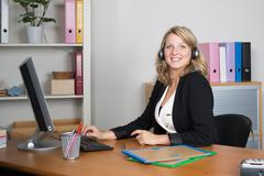 business, communication and call center concept - friendly female helpline op - stock photo