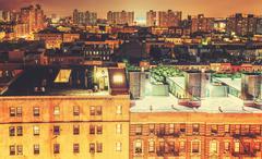 Retro toned Harlem neighborhood at night, NYC, USA. Stock Photos