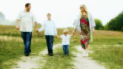 Happy joy cheerful full family, Caucasian parents and two children walking  - stock footage