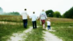 Happy cheerful full family, Caucasian parents and two children walking  - stock footage
