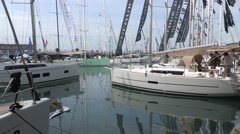 White sailboats at Genoa Boat Show 2015 Stock Footage