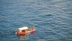 People swimming on traditional malteze boat luzzu in Malta bay near Valletta Stock Footage