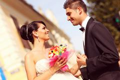Beautiful bride and groom celebrating wedding day in the city Stock Photos