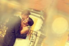 Beautiful bride and groom celebrating wedding day in the city - stock photo