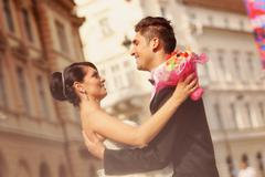 Stock Photo of Beautiful bride and groom celebrating wedding day in the city