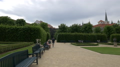 Sitting on benches and walking in Wallenstein Garden, Prague Stock Footage