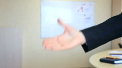 Business people shake hands in two stages Stock Footage
