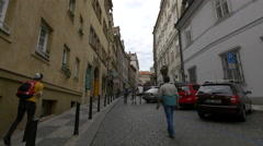 Tourists walking on Thunovská Street in Prague Stock Footage