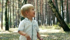 Cheerful joyful kid child baby boy in the romantic forest. Childhood Memories Stock Footage
