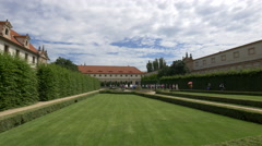 Tourists visiting the symmetrical Wallenstein Garden in Prague Stock Footage