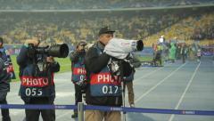 Photographers work at the stadium Stock Footage