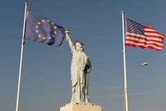 USA and European Union flags, Alliance.  Statue of Liberty, Blue sky backgrou Stock Photos