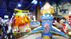 Adults and children in amusement park, colorful illuminated carousel  Stock Footage