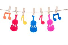 clip on a  twine , hanging colorful music symbol and Guitar - stock photo