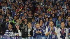 Spectators watch a football match. People, crowd, football fans - stock footage
