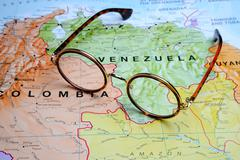 Glasses on a map - Venezuela - stock photo