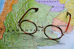 Glasses on a map - Buenos Aires - stock photo