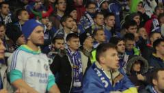 football fans at the stadium during the match. People, crowd, football fans - stock footage