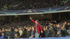 The fans sing songs at the stadium. People, crowd, football fans Stock Footage
