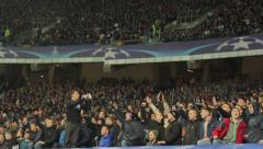 Football fans at the stadium. People, crowd, football fans - stock footage