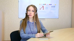 Female hot linе operator responds to customer request, office people on the - stock footage