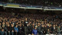The fans sing at the stadium during the match. People, crowd, football fans - stock footage