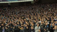 A large crowd of spectators at the stadium. People, crowd, football fans - stock footage