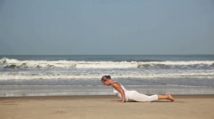Yoga on the beach Stock Footage