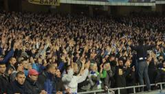 Football fans at the stadium clap. People, crowd, football fans - stock footage