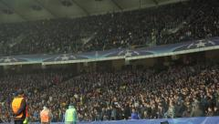 A large grandstand stadium with people during the match. People, crowd, football - stock footage
