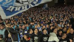 football fans support their team at the stadium. People, crowd, football fans - stock footage
