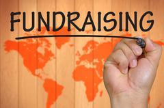 hand writing fundraising - stock photo