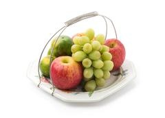 Isolated platter of assorted fruit - stock photo