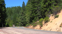 A logging truck travels on a mountain road. Stock Footage