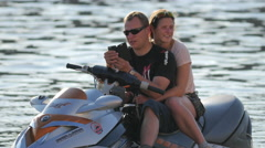 Couple floating on a jet ski on Vltava River, Prague Stock Footage
