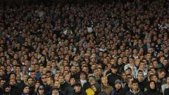 The spectators at the stadium. People, crowd, football fans - stock footage