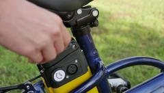 Girl connects the charger to the electric bicycle. Tracking. Stock Footage